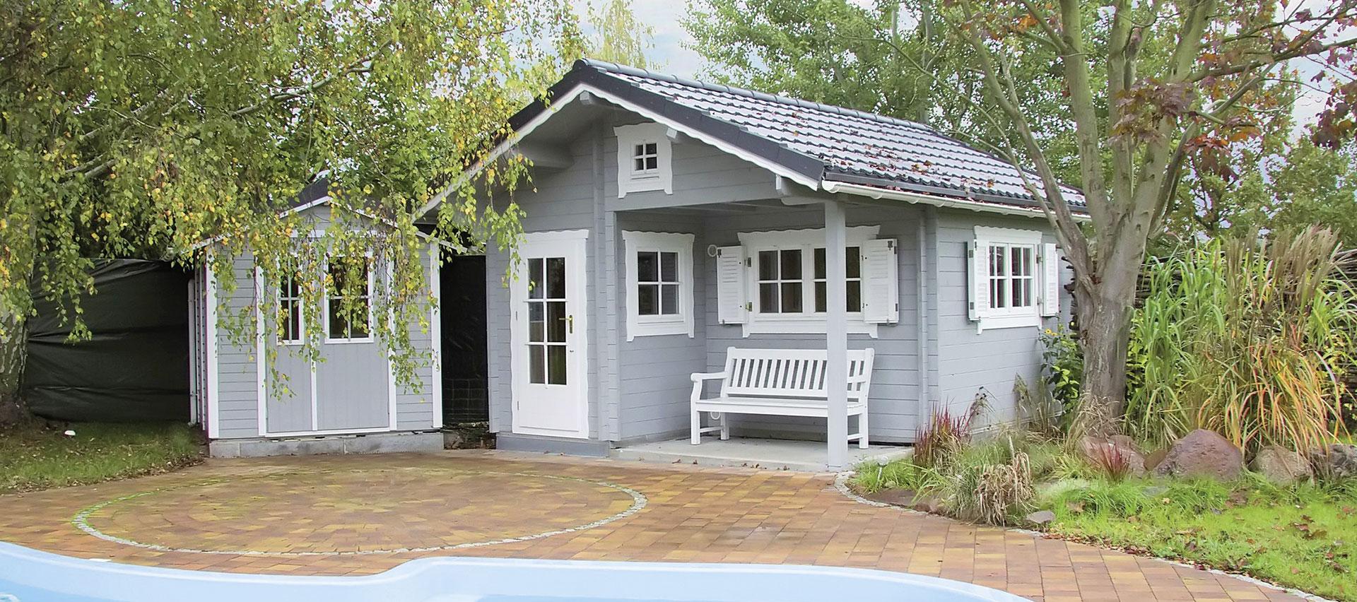 Gartenhäuser aus Holz im Garten von Holz-Hauff in Leingarten