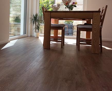 Referenzen zu dunklem Designboden von Holz-Hauff in Leingarten